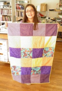 First quilt by young sewing student