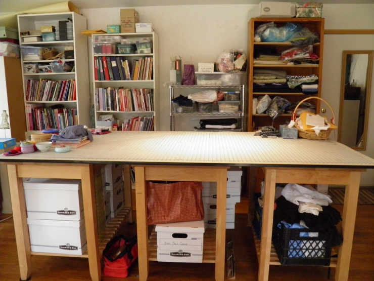 Cutting table with bookshelves behind