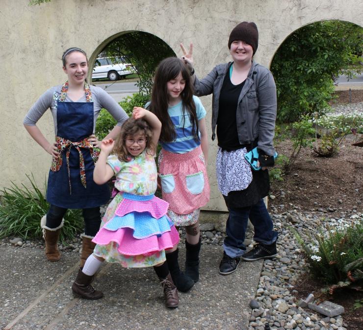 Four girls at Sew Maris Kids Sew Camp made aprons