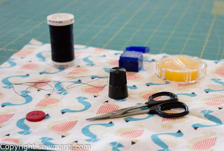 How to sew a button by Sew Maris
