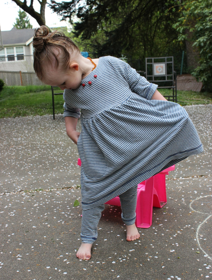Toddler wearing Oliver and S Playtime dress by Sew Maris and checking out the pockets